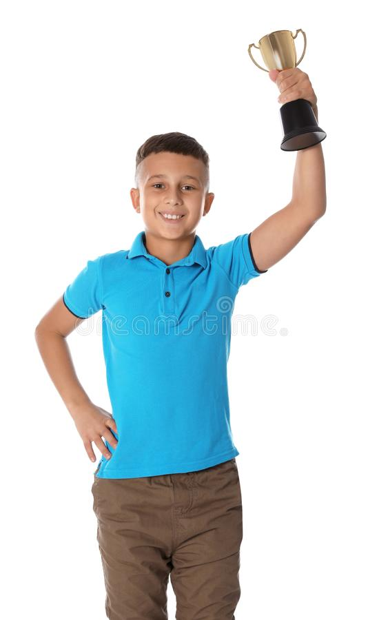 Happy boy with golden winning cup. On white background stock image