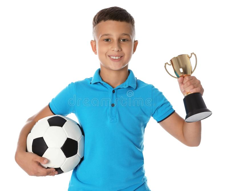 Happy boy with golden winning cup and soccer ball on white. Background royalty free stock image