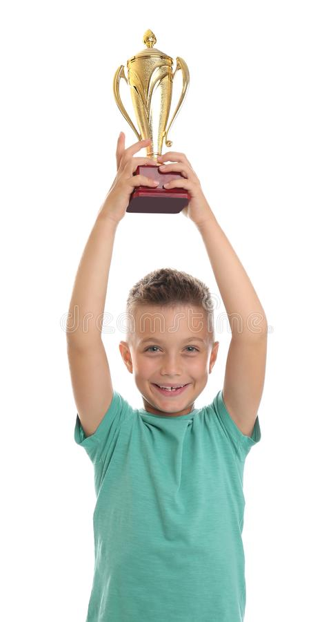 Happy boy with golden winning cup on white. Happy boy with golden winning cup isolated on white stock image