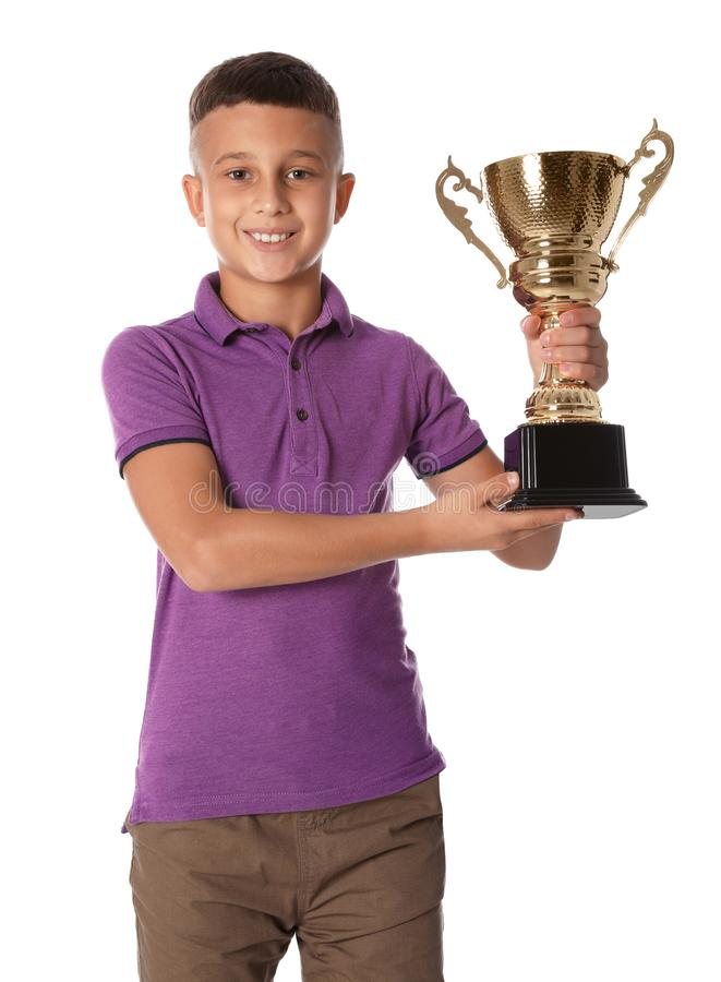 Happy boy with golden winning cup on white. Background royalty free stock images
