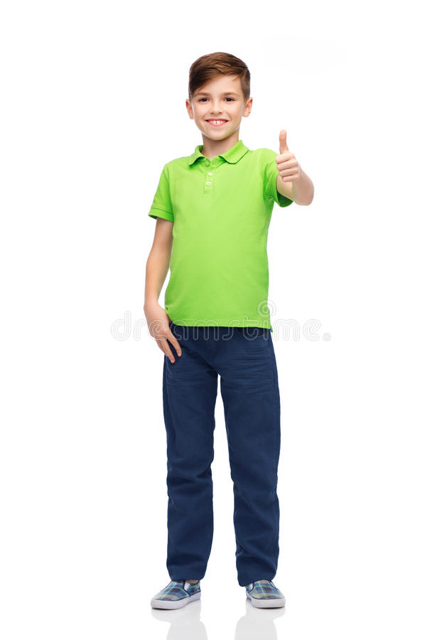 Happy boy in green polo t-shirt showing thumbs up. Gesture, childhood, fashion and people concept - happy smiling boy in green polo t-shirt showing thumbs up royalty free stock photos