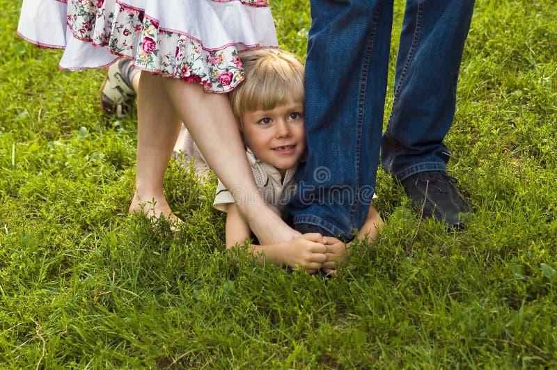 Download Happy Boy Hiding In Parents Legs Stock Photo - Image: 6329674
