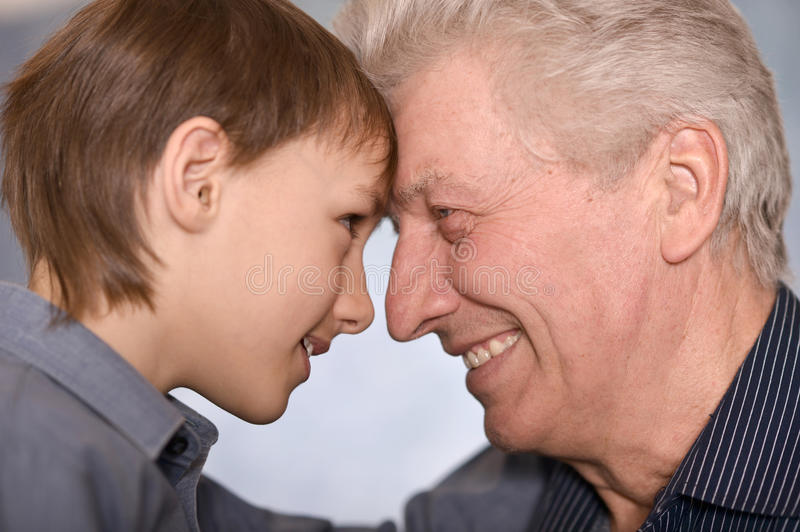 happy boy and his grandfather royalty free stock photos