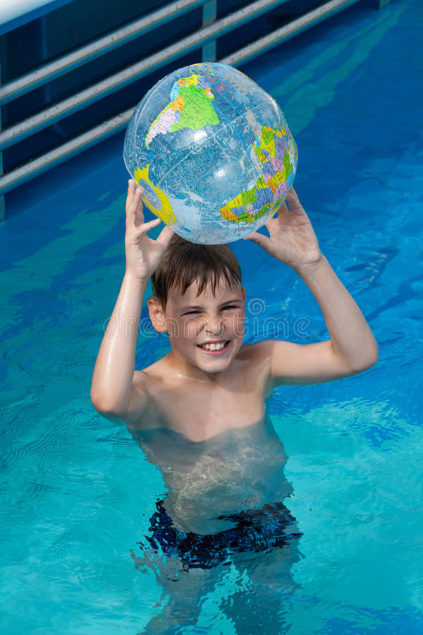 Download Happy Boy Hold Inflatable Globe  In Pool Stock Photo - Image: 26281338