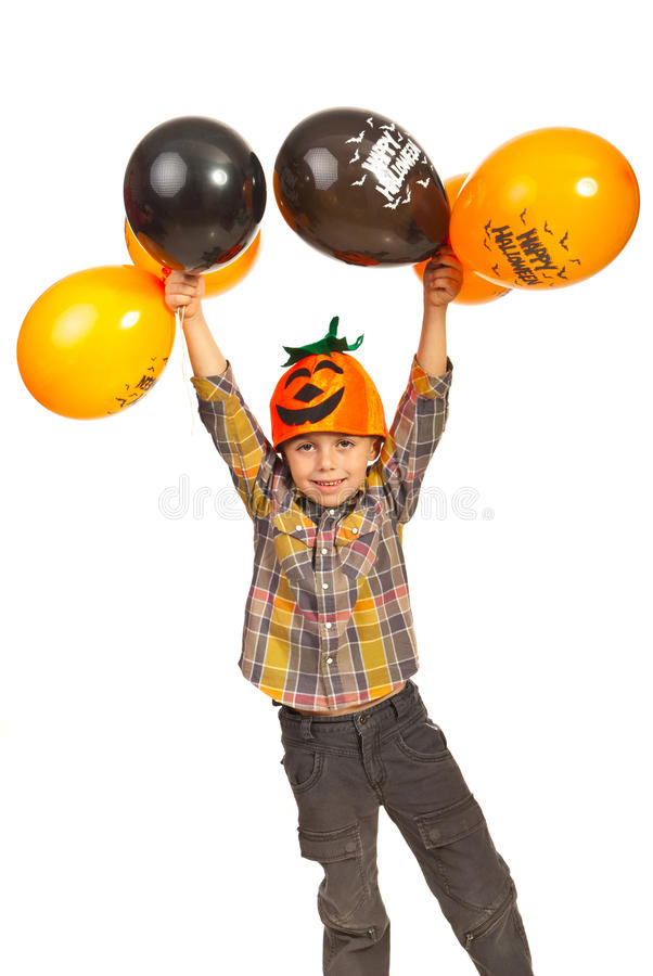Download Happy Boy Holding Halloween Balloons Stock Photo - Image of child, casual: 27467734