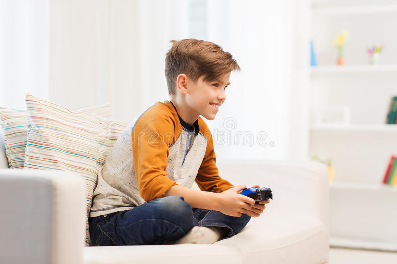 Happy Boy With Joystick Playing Video Game At Home Stock Image ...
