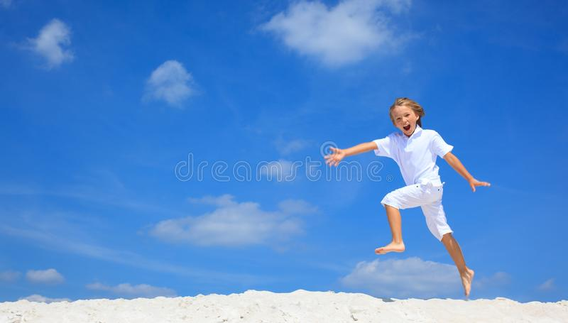 Download Happy boy jumping on beach stock photo. Image of leaps - 11448024