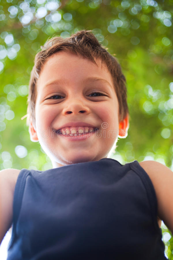 Happy Boy Laughing In Sunlight Stock Photography