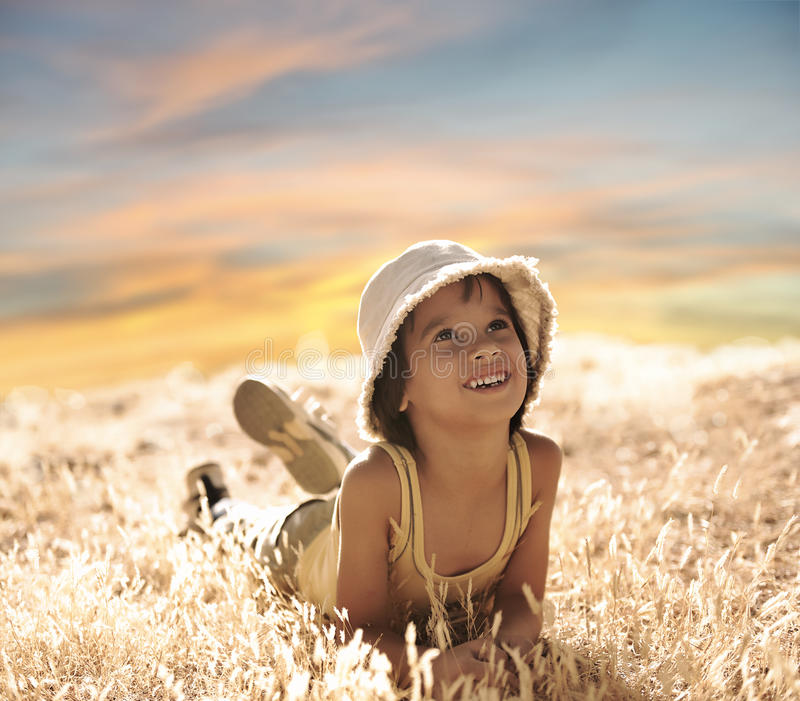 Download Happy Boy Laying On Ground Stock Photography - Image: 22277712