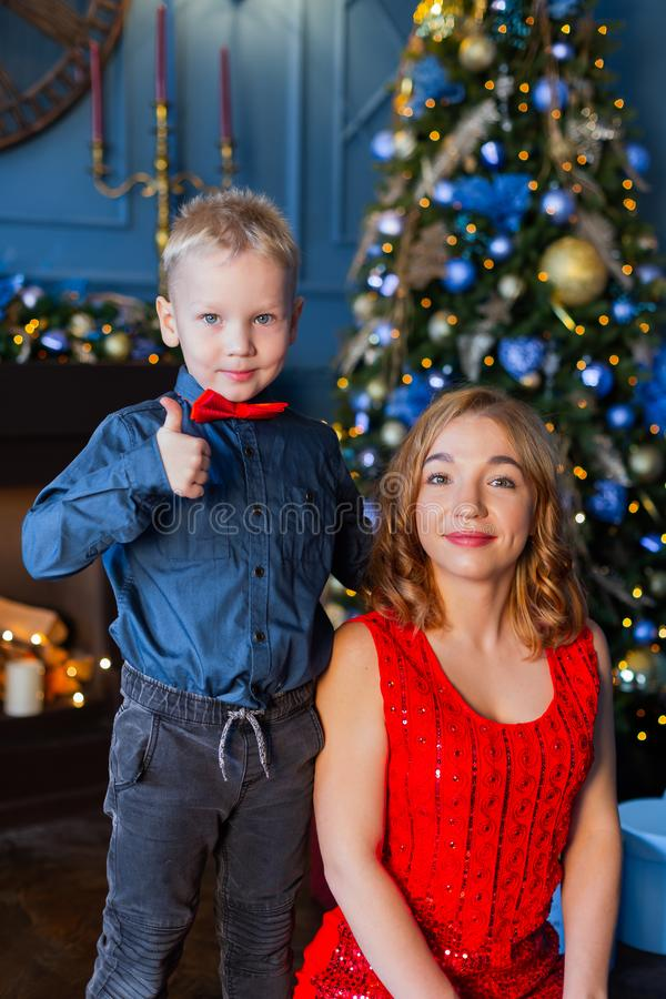 Happy boy with mom in New Year`s decor. royalty free stock photo