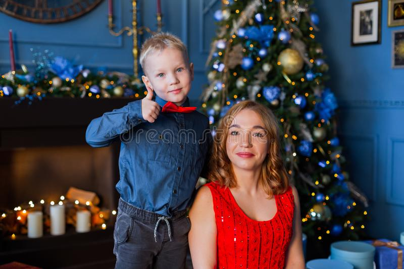 Happy boy with mom in New Year`s decor. royalty free stock image