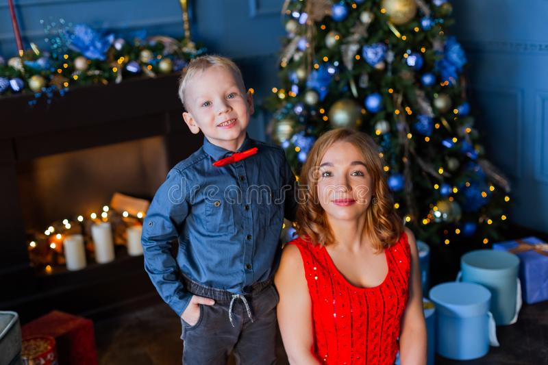 Happy boy with mom in New Year`s decor. royalty free stock photos