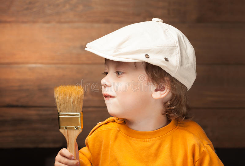 Happy boy with paint brush royalty free stock photography