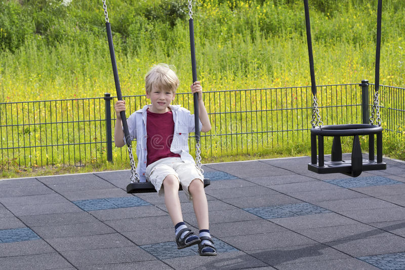 Happy boy on the playground stock images