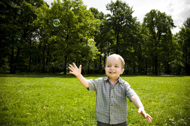Download Happy boy playing in field stock image. Image of plays - 5527821