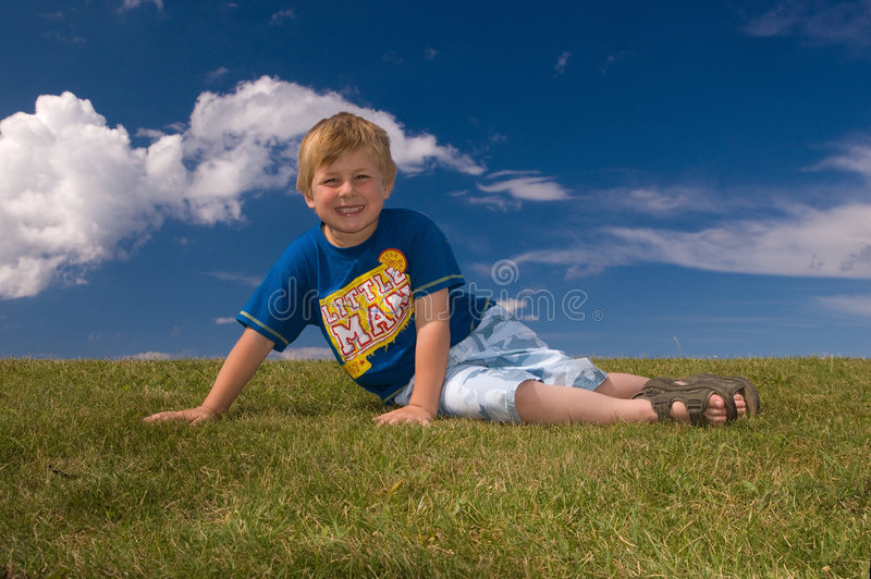 Download Happy boy relaxing stock photo. Image of relaxing, clouds - 5957128