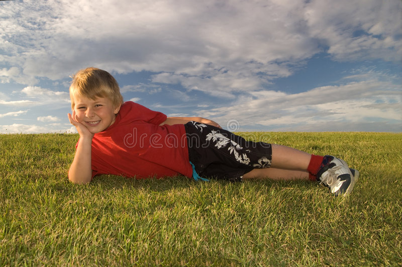 Download Happy boy relaxing stock photo. Image of youth, lying - 6087454