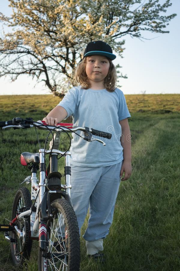Happy boy ride bikes outdoors stock photos