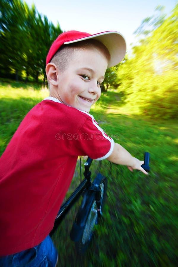 Happy  Boy Rides A Bike Royalty Free Stock Photo