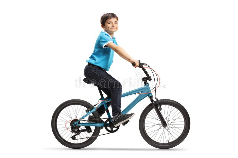 Happy boy riding a bicycle stock photography