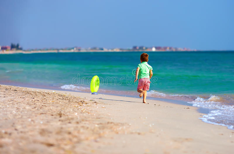 Download Happy Boy Running The Beach For Rubber Ring Stock Image - Image: 34121249