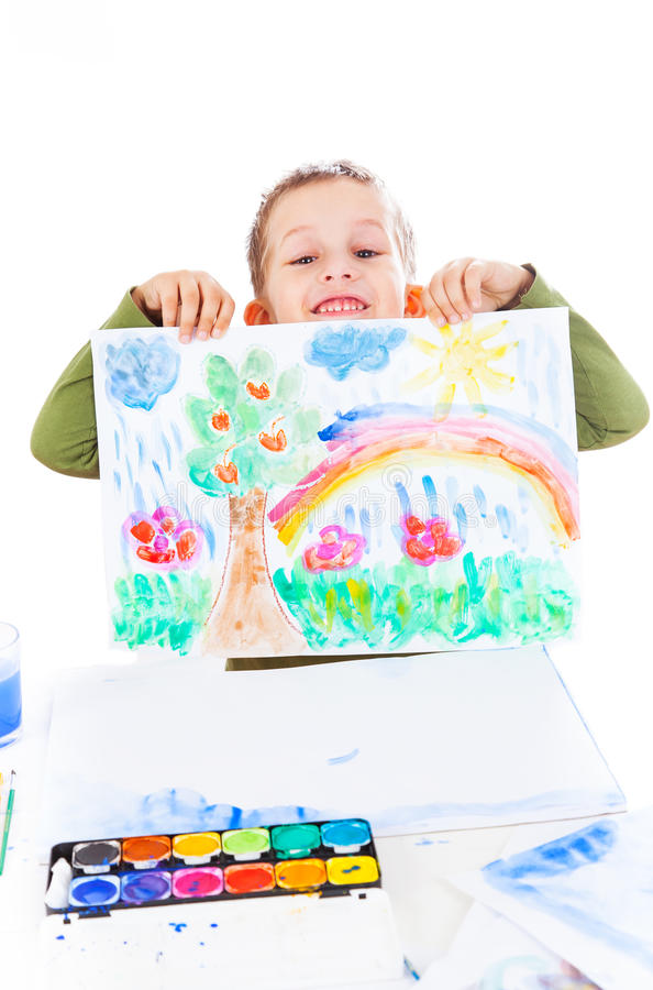 Happy boy showing his painting stock image