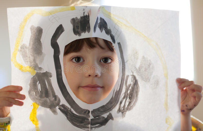 Happy boy shows his drawing at home royalty free stock images