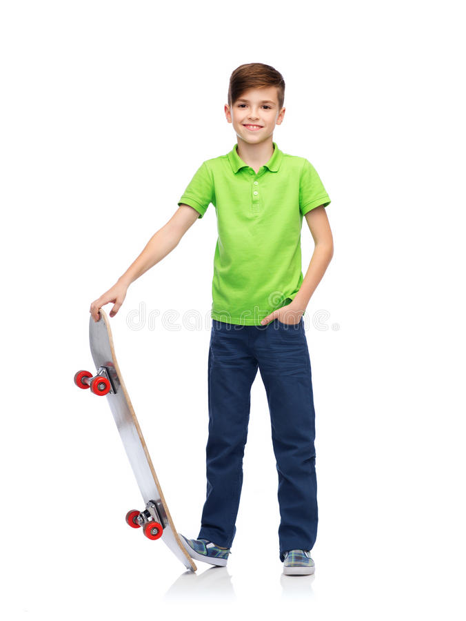 Happy boy with skateboard. Childhood, leisure, school and people concept - happy smiling boy with skateboard royalty free stock photo