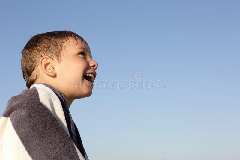 Happy boy on a sky background stock photo