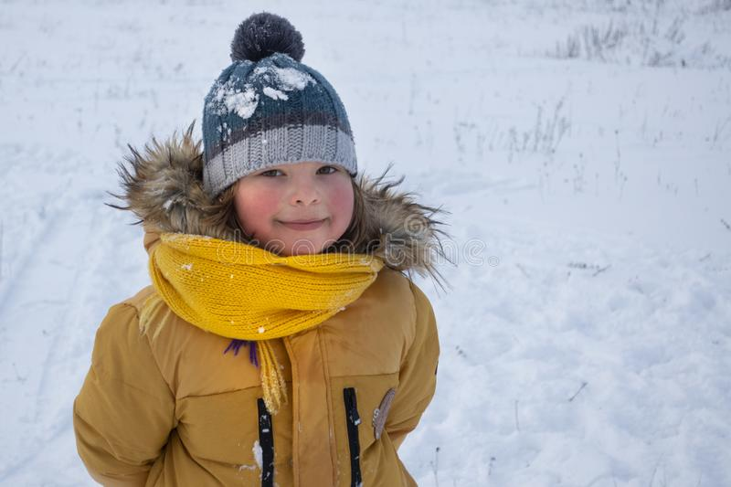 Happy boy in snow play and smile sunny day outdoors stock image