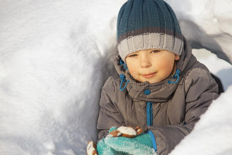 Happy boy in snow play and smile sunny day outdoors royalty free stock photos