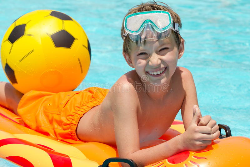 Happy boy in swimming pool royalty free stock photography