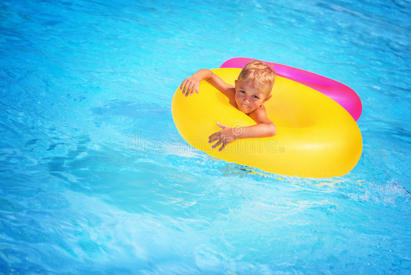 Happy boy in swimming pool royalty free stock image