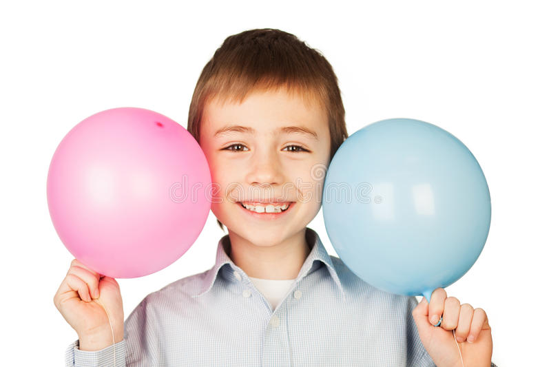 Happy boy with two balloons royalty free stock photo