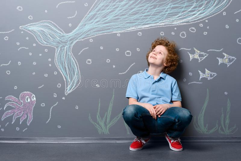 Happy boy under the sea stock images