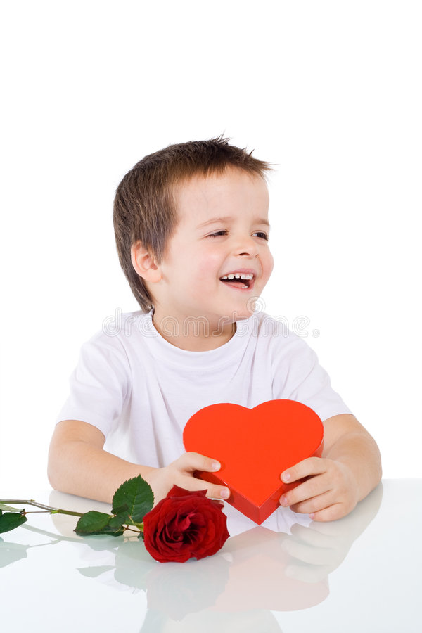 Happy boy with valentines or birthday present. Isolated stock photo