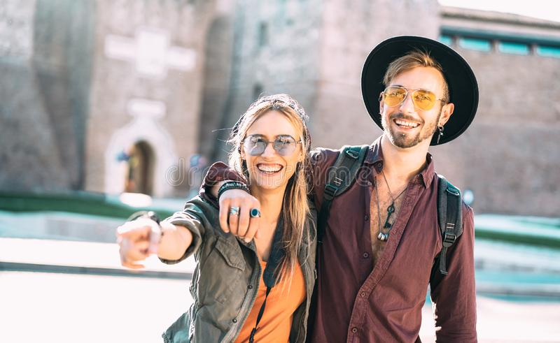 Happy boyfriend and girlfriend in love having genuine fun walking in city center - Wanderlust life style and travel vacation royalty free stock images