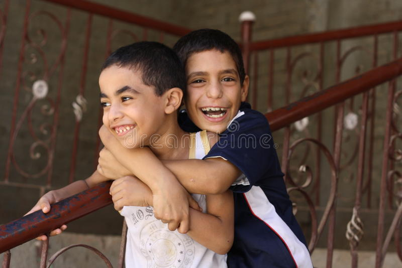 Happy boys playing in the street in giza, egypt stock photos