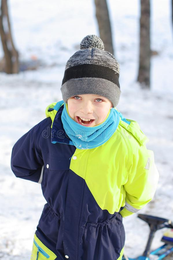 Happy boys playing on a winter walk in nature. Children jumping and having fun in winter park.  stock photos