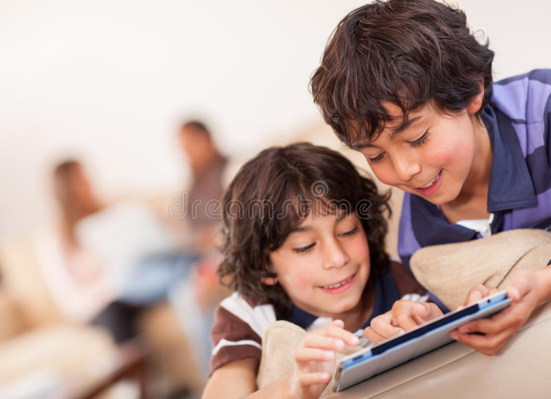 Download Happy boys with a tablet stock photo. Image of indoors - 24936928