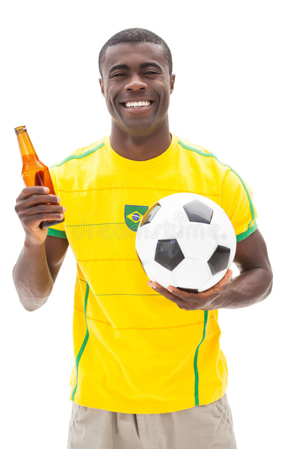 Download Happy Brazilian Football Fan Holding Ball And Beer Stock Image - Image: 42560947