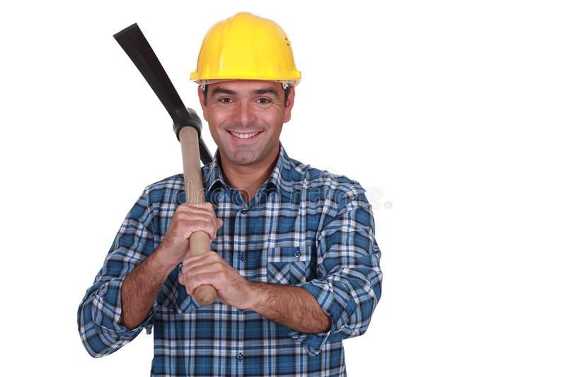 Happy bricklayer holding pickaxe. Isolated on white stock photo