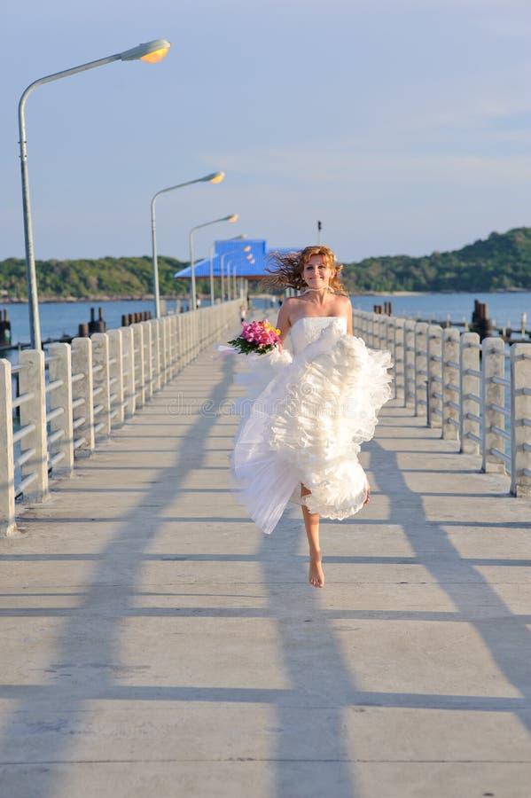 Happy bride on the bridge
