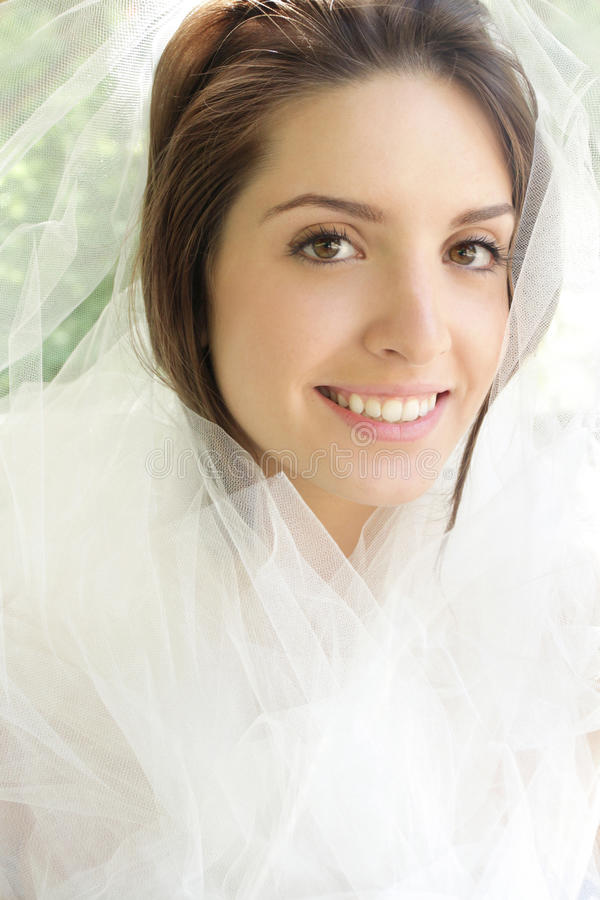 Happy Bride: Girl with Tulle Veil stock photo