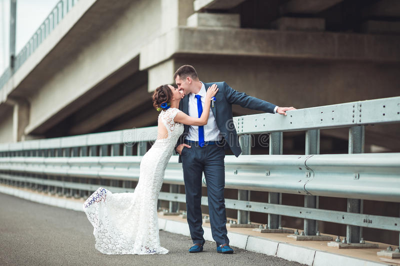 Happy bride and groom celebrating wedding day. Kissing married couple. Long family life concept royalty free stock images