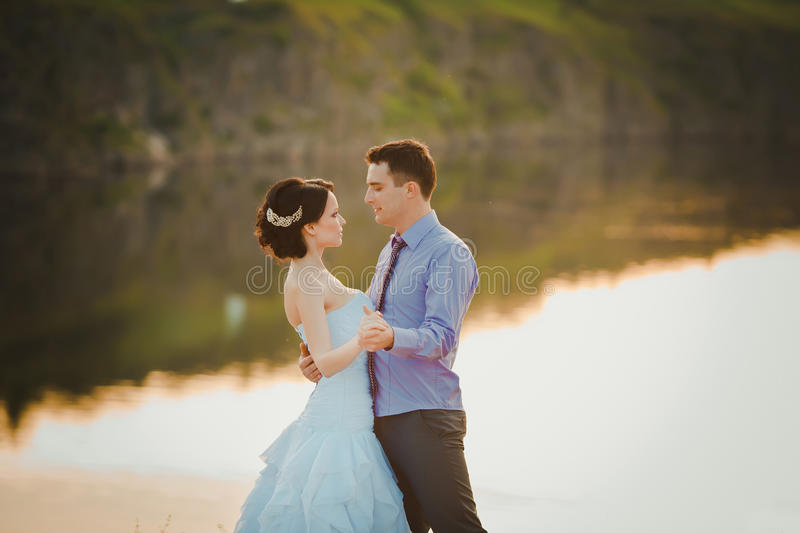 Happy bride and groom celebrating wedding day. Married couple holding each other hands. stock photo