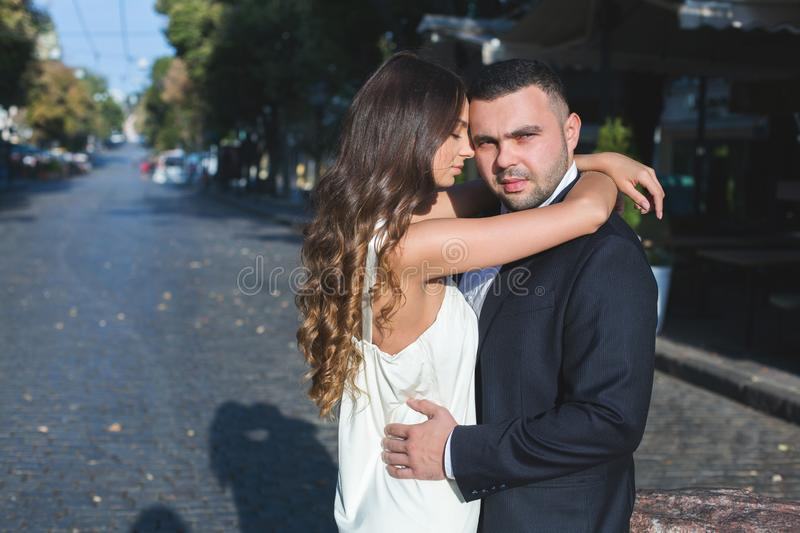 Happy bride and groom. Cheerful married couple. Just married couple embraced. Wedding couple.  royalty free stock image