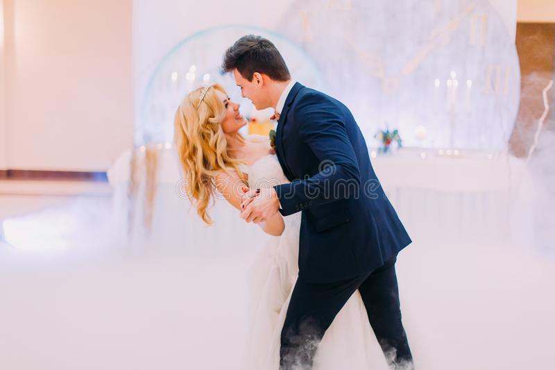 Happy bride and groom gracefully dance. Wedding celebration stock image