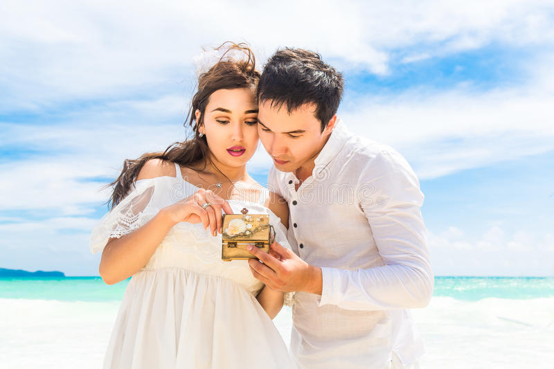 Happy Bride and Groom having fun on the tropical beach. Wedding royalty free stock photos