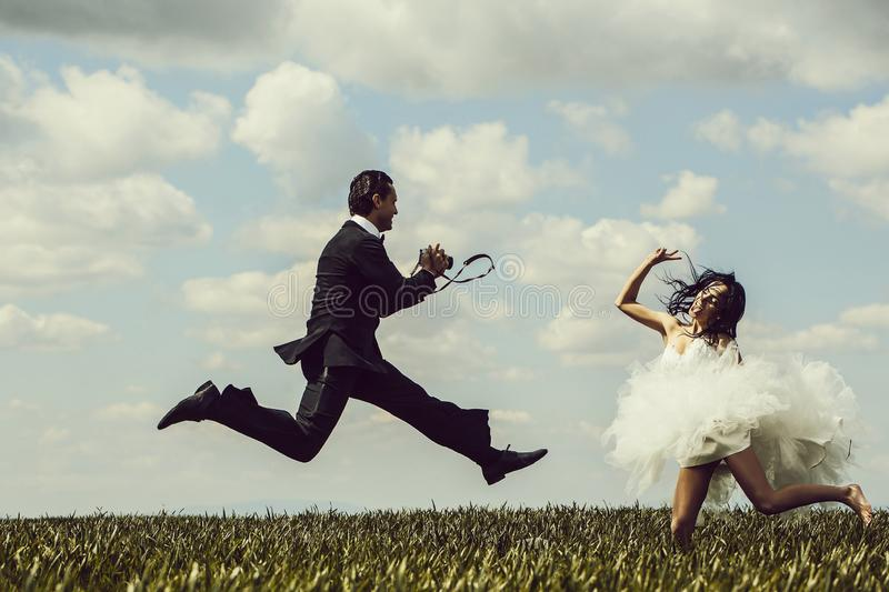 Happy bride and groom jump royalty free stock photography